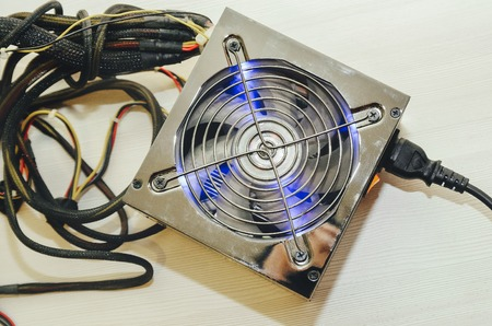 sata: Power supply for computer close-up on white background