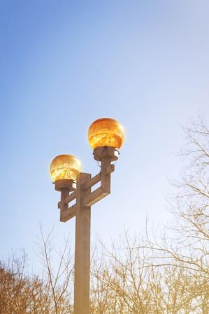 plafond: Lantern with yellow plafond on the sky background. Stock Photo