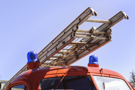 antique fire truck: Fire escape on the fire red car close-up. Stock Photo