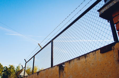 Fence with barbed wire. Rabitz.