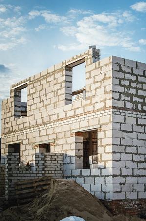 Unfinished country house of white stone blocks. Zdjęcie Seryjne