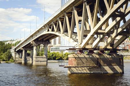 Bridge over the river, close-up. Russia, the Volga. Stock Photo