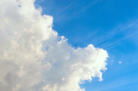 Blue sky with white Cumulus clouds. Day, background.