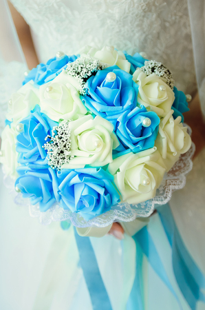 Beautiful bridal bouquet of white and blue roses. Close-up.