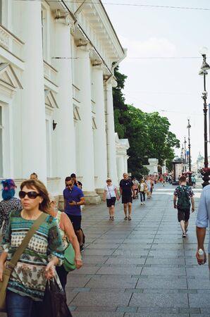 Saint Petersburg, RUSSIA - July 13, 2018: People walk along Nevsky Prospect in St. Petersburg. Vertical photo.