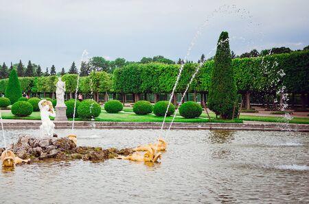 Saint Petersburg, RUSSIA - July 11, 2018: Sights of St. Petersburg. Beautiful park fountains in Peterhof.