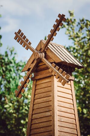 Decorative wooden weather vane. Decoration of a country house.