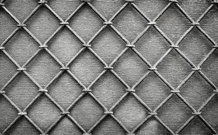 Gray metal grill. Fragment of a decorative wall.