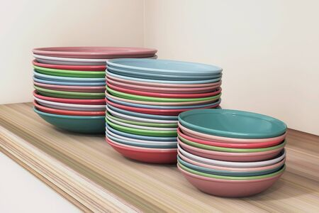 A stack of multi-colored clean ceramics plates in a restaurant, close up Stockfoto