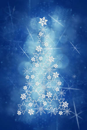 Christmas and New Year blue background with Christmas tree made from white snowflakes. Blurred christmas background with bokeh.