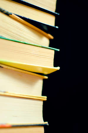 Stack of books. Selective focus, close-up.