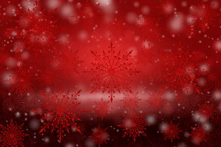 Decorated snowflakes on blurred red background with bokeh.
