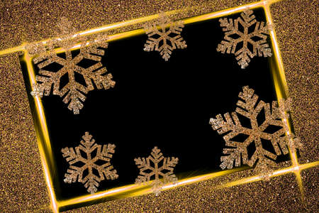 Gold decorative snowflakes on a black background in a frame.