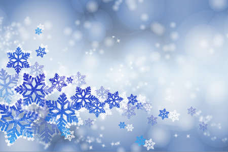 Winter blue background with snowflakes and snow flakes.