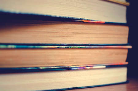 stack of books, Close-up, selective focus. Instagram style toning.