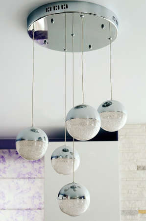 Beautiful modern ball shaped chandelier hanging from the ceiling.
