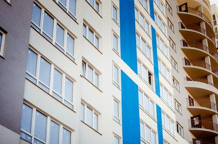 Facade of a multi-storey building. Fragment Standard-Bild
