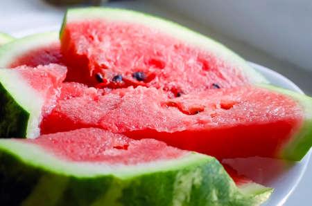 Sliced ripe sweet watermelon lies on a plate. Standard-Bild