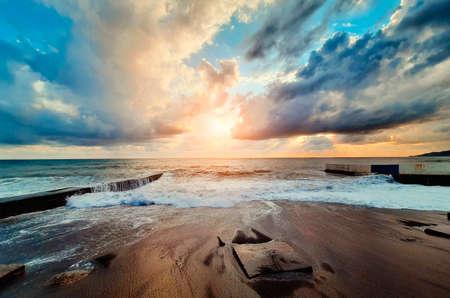Beautiful seascape. Sea waves against the setting sun.