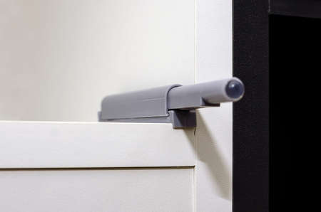 Cabinet doors push to open touch latch close-up