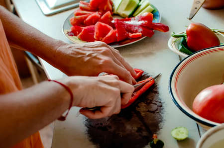 Close-up of hands are cutting vegetables. Homemade food.
