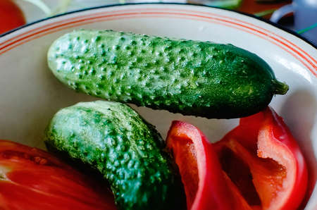 Green cucumbers and bell peppers. Healthy food, eat at home. Standard-Bild