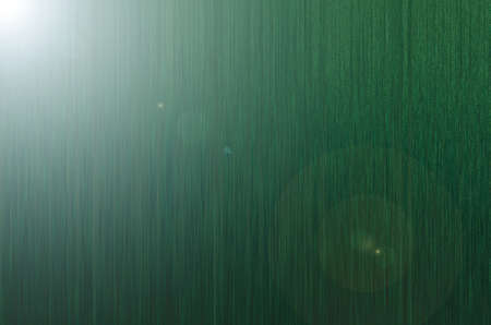 Green textured background with flare. Simple background for design.