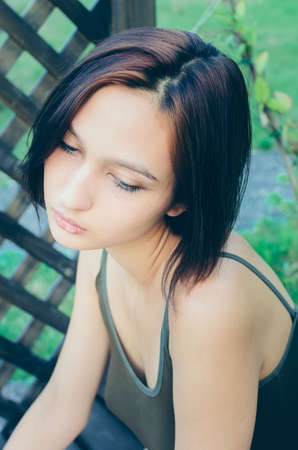 Portrait of a beautiful dark-haired girl with a bob haircut, close-up.