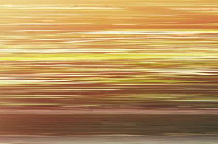 Yellow-orange simple background with horizontal texture.