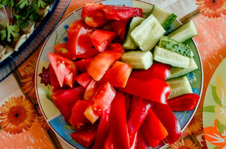 Sliced cucumbers and tomatoes. Salad ingredients. Close-up, selective focus.