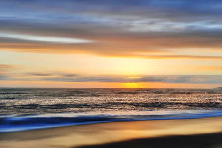 Beautiful sunset over the sea, blurred background for design.