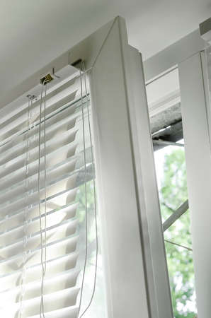 Blinds attached to the window, close-up.