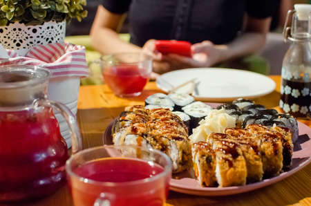 Japanese cuisine, rolls and sushi, close-up, selective focus. Served table in a cafe. Standard-Bild