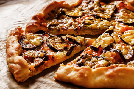 pizza with eggplant on a dark background. tinting. selective focus on middle of pizza Imagens