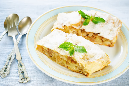 Apple strudel on a light blue background. tinting. selective focus on mint
