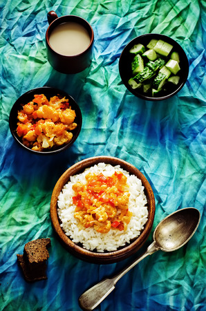 pongal: rice with curry cauliflower on a green  Stock Photo