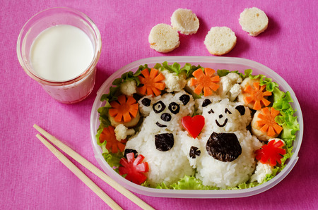 Bento in the form of bears in a box on a pink background photo