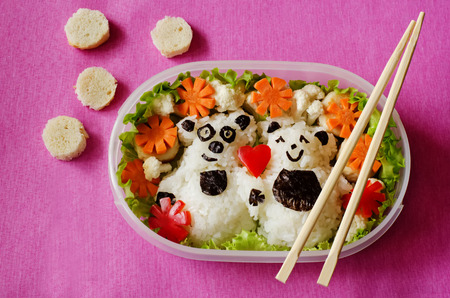 Bento in the form of bears in a box on a pink background Stock Photo