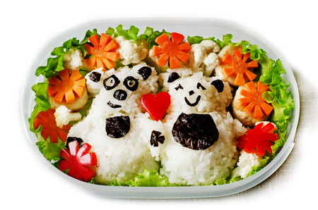 Bento in the form of bears in a box on a white background Фото со стока