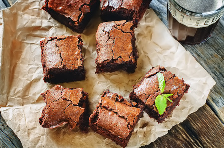 autumn food: brownie on a dark wood background. tinting. selective focus on mint