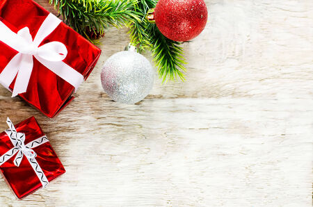 happy holidays: Christmas background with gifts on a light woody background. tinting. selective focus on gift Stock Photo