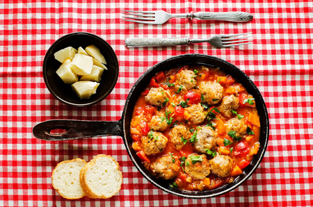 meatballs baked with vegetables on a red white background. tinting. selective focus Stock Photo - 33790210