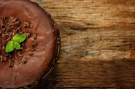 chocolate cheesecake with chocolate glaze on dark wood background. tinting. selective focus Stock Photo