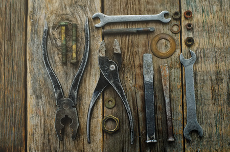 old tools on a dark wood background. Stock Photo