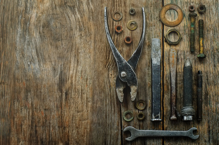 old tools: old tools on a dark wood background.  Stock Photo