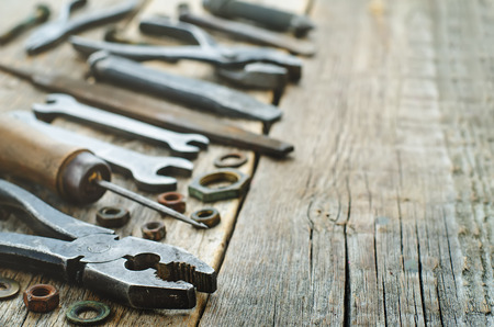 old tools on a dark wood background.  photo