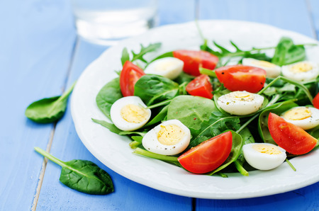 tinting: salad with arugula, spinach, tomatoes and eggs. tinting. selective focus Stock Photo