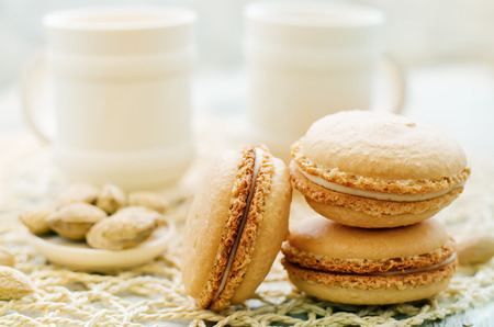 tinting: macaron with cream cheese on a light background. tinting. selective focus