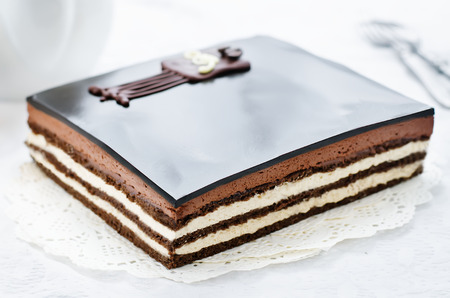 Opera cake on a white background. tinting. selective focus Stock Photo
