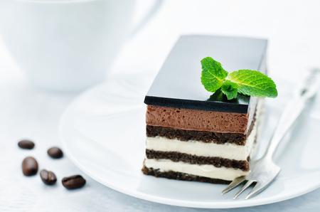 Opera cake on a white background. tinting. selective focus Stock Photo